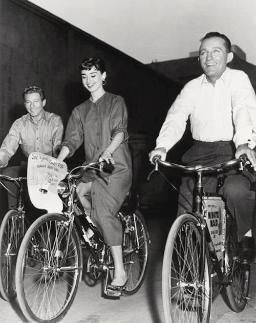 Paramount Studios, 1954: Actors Danny Kaye and Bing Crosby go for a ride with Audrey Hepburn.