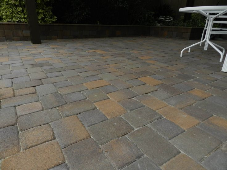 Pavescapes Patio Overlay installation. Paver color used in this photo is Catalina (Color is off due to time of photo taken) #naturalstone #pavers #remodel #construction