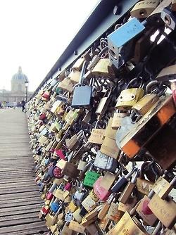 Pin a lock on the love bridge in Paris.