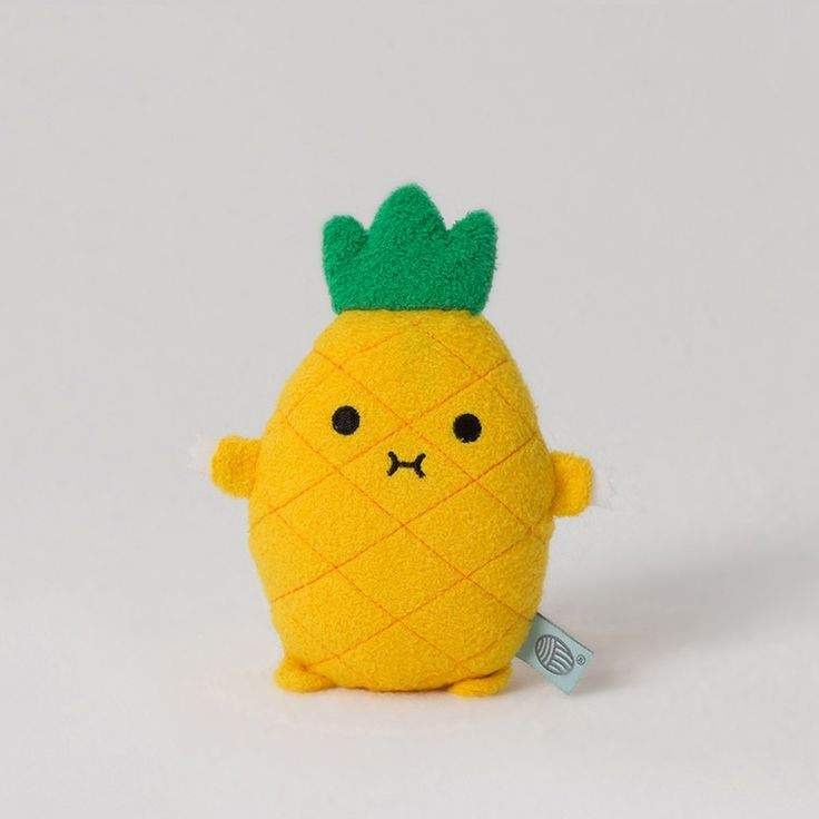 Riceananas is one totally tropical toy! This spiky little pineapple is ready for some fun in the sun but don't worry, he's happy to chill out indoors too. Riceananas has bright yellow super soft fur, an embroidered body and face and the cutest little spiky but soft top. Riceananas has a handy strap which you can attach to bags, prams, your baby cot or anywhere else you might need a pal. Perfect for babies to cuddle and chew and for grown ups to collect and display!