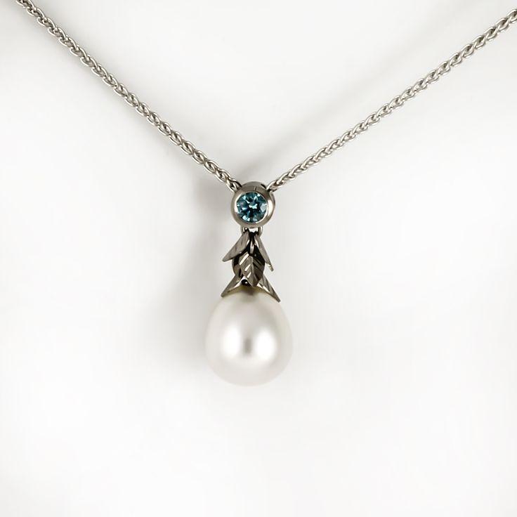 Unique south sea pearl necklace with blue diamond.