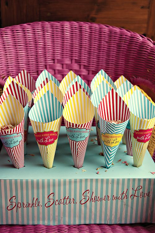 Buffet popcorn cones with fold top (find fold top so stuff stays inside) Put blank stickers on with carnival style shape so people can write their names on it