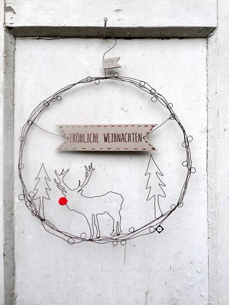 """Türkranz aus Draht getüddelt mit weihnachtlichem Gruß """"Fröhliche Weihnachten"""". Ø 26 cm ."""