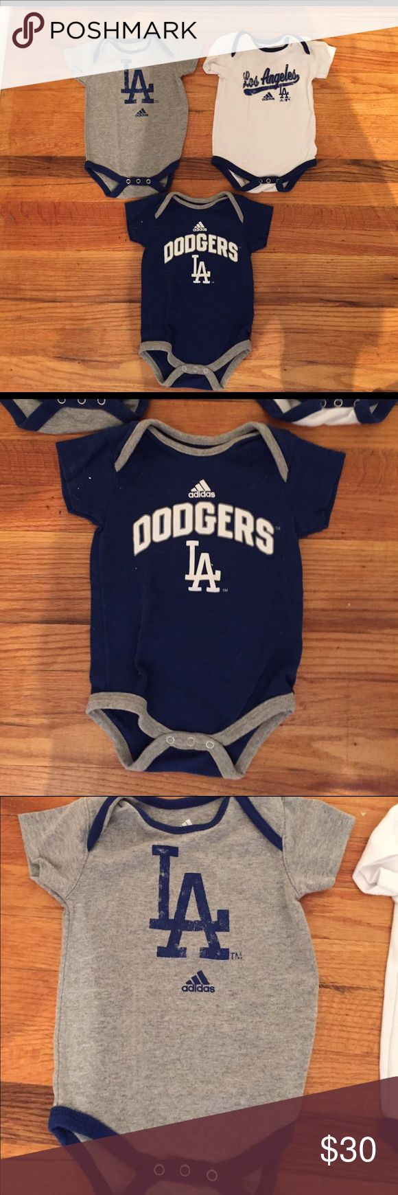 Adidas official dodger 12 month onesie! Adidas official dodger 12 month onesie! I am selling them as a set of 3. They all came together so it's $30 for all 3!! $10 each is an amazing deal! Bought at dodger stadium Adidas One Pieces Bodysuits