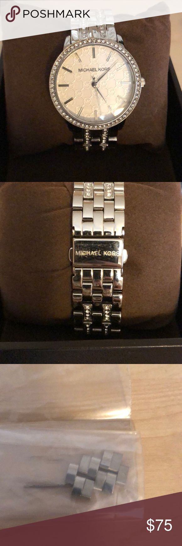Authentic Michael Kors Watch Silver tone women's Michael Kors watch. MK logo on the face, Pave around the face and throughout the band. Comes with original box and has extra links. Michael Kors Accessories Watches