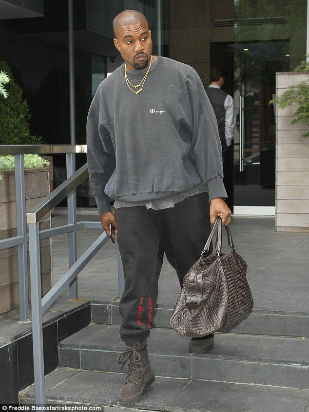 Following her lead: Kanye also dressed down as he stepped out of his Manhattan apartment on Saturday