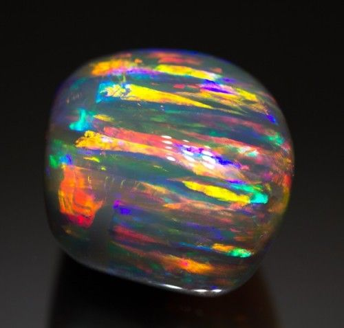The Rainbow Serpent Opal (30.56 carats) - Lightning Ridge, NSW, Australia See it on video here.