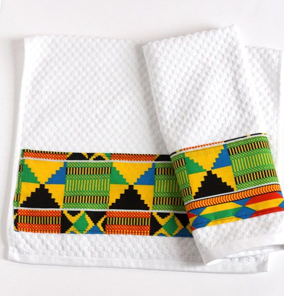 Take Some Absorbent Cotton Towels Add In African Print Embellishment Finally Round It All Off With Social Impact African Decor Sewing Projects African Print