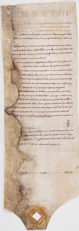 Diplôme en latin de 1111 par lequel le roi Louis VI, après avoir fait prisonnier le seigneur du Puiset, fait raser son château et abolit les coutumes établies par ce seigneur sur les terres de l'abbaye de Saint-Denis. Archives Nationales.