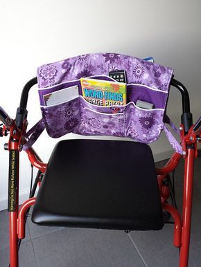 This interchangeable padded walker bag is sized to fit standard and larger walkers. It too functions well on a rollator or seating rolling walker. Drapes easily over horizontal bar with lots of pockets for easy to reach items such as; handheld phone, reading glasses, TV remote, meds, writing pads and pens, magazines, tissues, needlework, and such. Features: * Made of 100% quality cottons in cheerful purple and lilac flowers with solid purple contrast on front pockets * All pockets trimmed in…