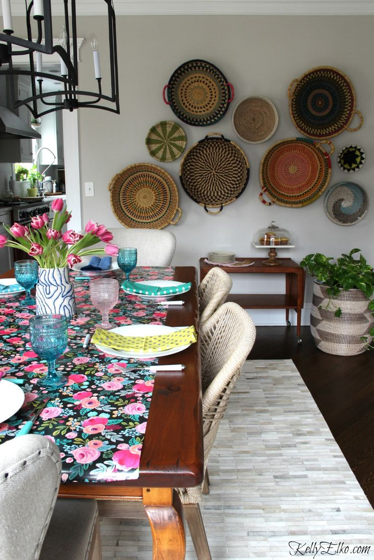 Spring Tablescape - love the floral table runner, pink and blue glasses and basket gallery wall all from HomeGoods kellyelko.com sponsored pin #gallerywall #diningroom #diningroomdecor #boho #bohostyle #thrift #tablesetting #cottagestyle