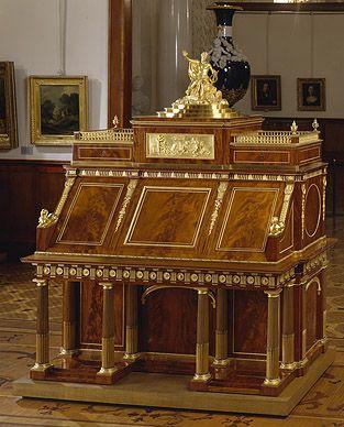 Mahogany bureau with a figure of Apollo. Veneering: outside - mahogany; inside - mahogany, hornbeam and palisander. Carcass: oak, cedar and solid mahogany Ormolu and brass 1873