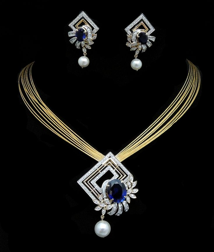 The Magnificent Tanzanite! Charu Jewels is crafted in 18 K gold and set with…