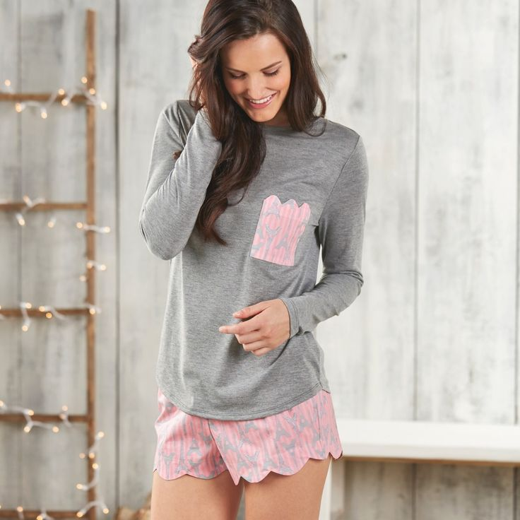 These great 2-piece pajama sets feature a long sleeve poly/rayon shirt with left chest pocket in contrasting print with scalloped edge finish. Comes with coordinating cotton boxer shorts with scallope