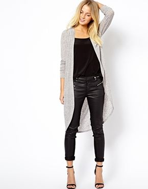 A long grey cardigan over black and black leather makes a lovely early Autumn look that shows everyone how its done.