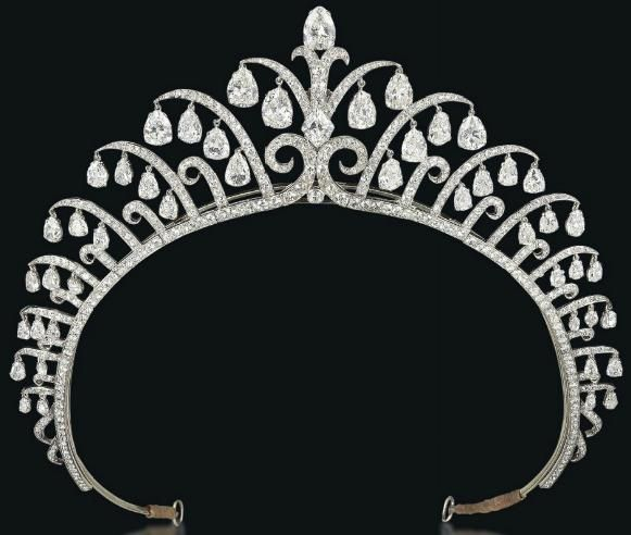 Tiara designed by Cartier in the 1920s, designed as a series of graduated diamond-set scrolls, each suspending pear-shaped diamond dangling pendants. It centers upon a lozenge-shaped diamond.