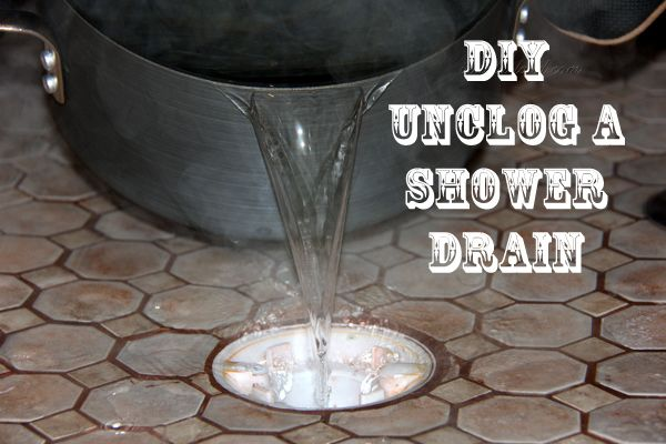 How to Unclog a Shower Drain ~ all you need is 1 cup salt, 1/2 cup vinegar, 1 cup baking soda, and 1/2 gallon boiling water!