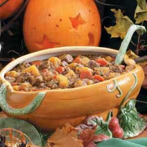 Autumn Savoury Stew - Ingredients:   1/2 cup all-purpose flour  1/2 teaspoon salt  1/2 teaspoon pepper, divided  2 pounds beef stew meat, cut into 1-inch cubes  2 tablespoons canola oil  2 tablespoons butter  1 large onion, chopped  2 to 3 garlic cloves, minced  3 medium carrots, thinly sliced  2 celery ribs, thinly sliced  4 cups water  1 to 2 Spice Islands® Bay Leaves  1 to 2 teaspoons beef bouillon granules  1 to 1-1/2 teaspoons dried thyme  3 cups cubed peeled pumpkin