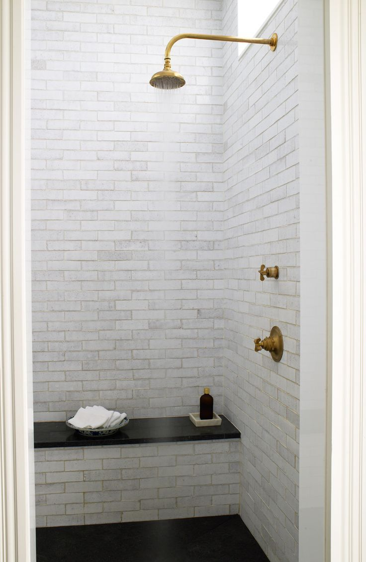 Loving this simple shower with brass fixtures.