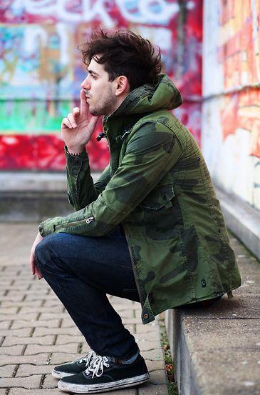 Khaki Jumper, the guy is smoking on street