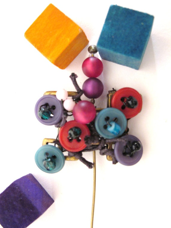 colourful brooch with metal, buttons and beads