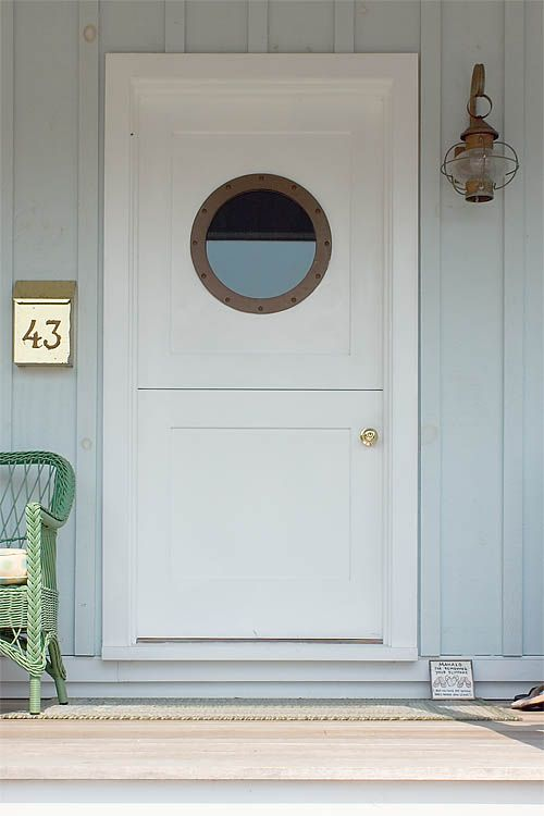 Dutch door with porthole window and onion globe lamp a for Round door design