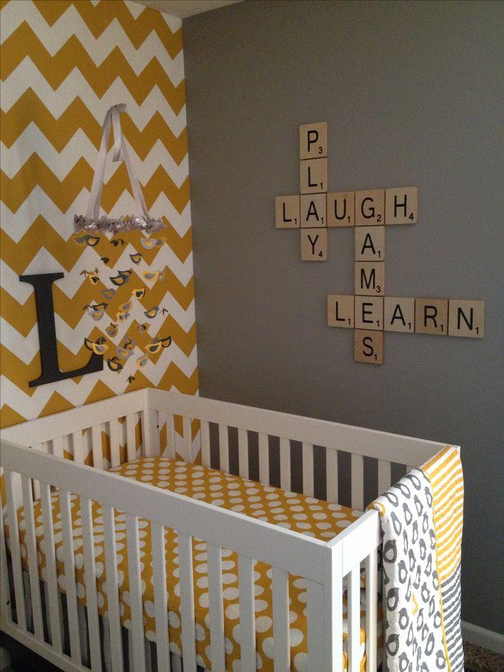 My twin's nursery - mustard chevron wall, scrabble tile letters on grey wall :)