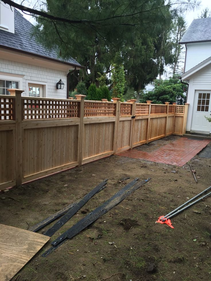 Cedar square lattice top fence with a