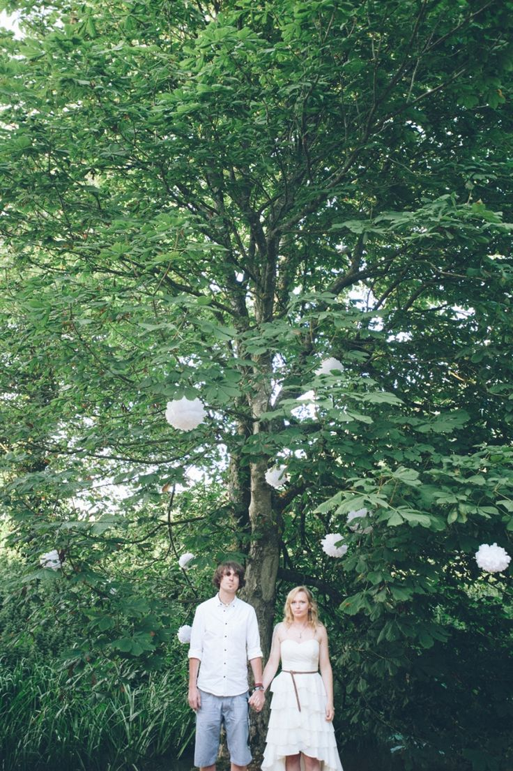 Paper pom poms in tree. Wedding venue decoration. Outdoor. nik & chris | an eco-friendly, handmade coastal welsh wedding » Home
