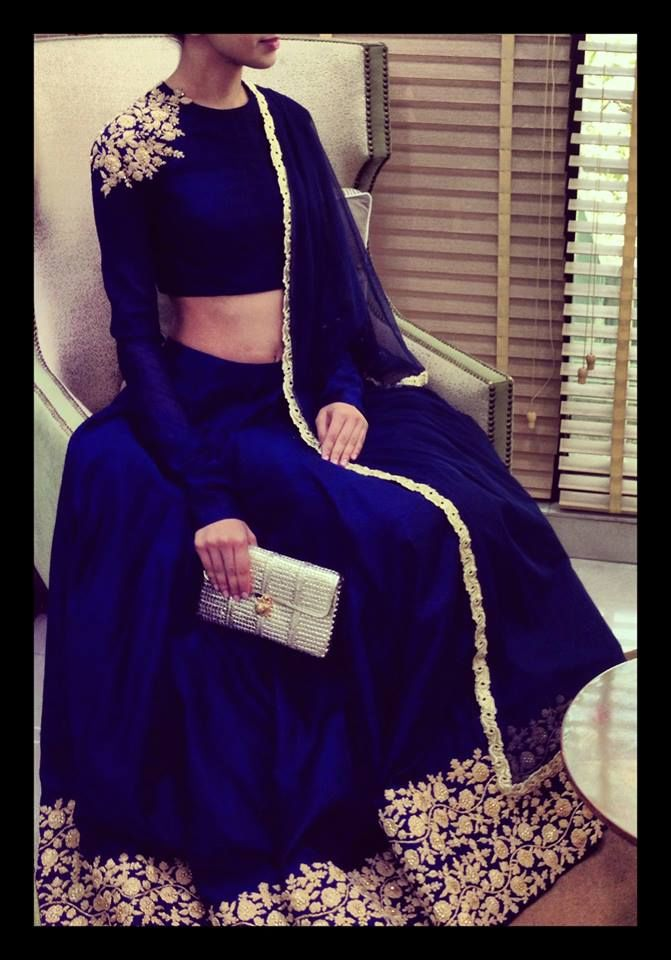 Royal blue lehnga with full sleeved blouse with embroidery on shoulders.. By Ridhi Mehra