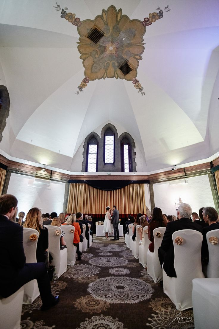 Bride and groom exchange their vows in the chapel at Shrigley Hall.