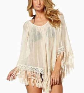 Gorgeous shimmering gold cover-up : Perfect for those long lazy beach days or hanging around the pool. The fabric is sheer and has a shimmering gold look to it. The tassels are soft and feel fantastic against your thighs. Buy today: