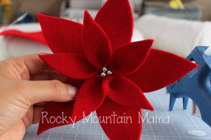 Aha!  A tutorial for making cute felt poinsettias!