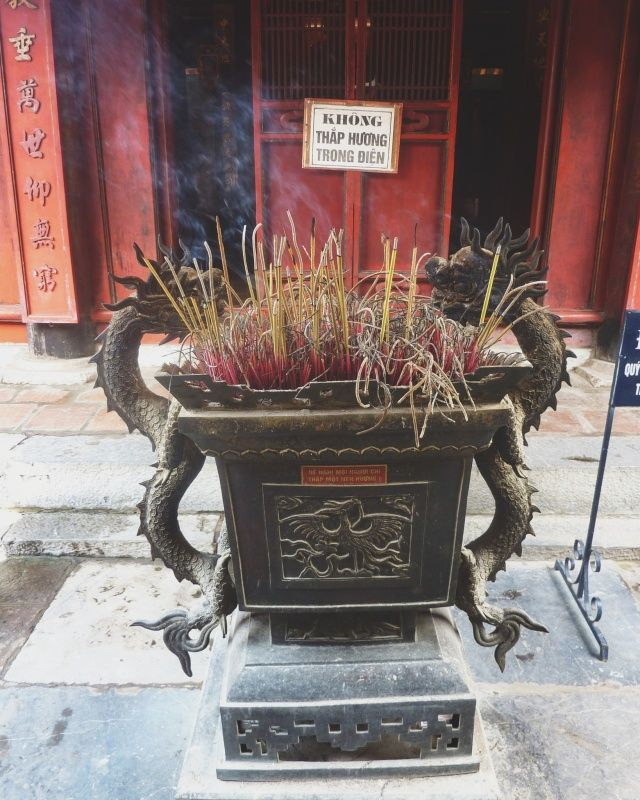 Burning incense in a red temple (Hoi an, Vietnam)   http://vsco.co/claranoona/images/1