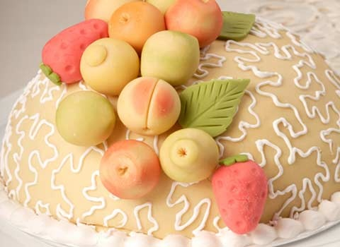 Sweet sweet sweet Bola de Oro (Golden Ball) Cake with Marzipan fruits directly from Peru