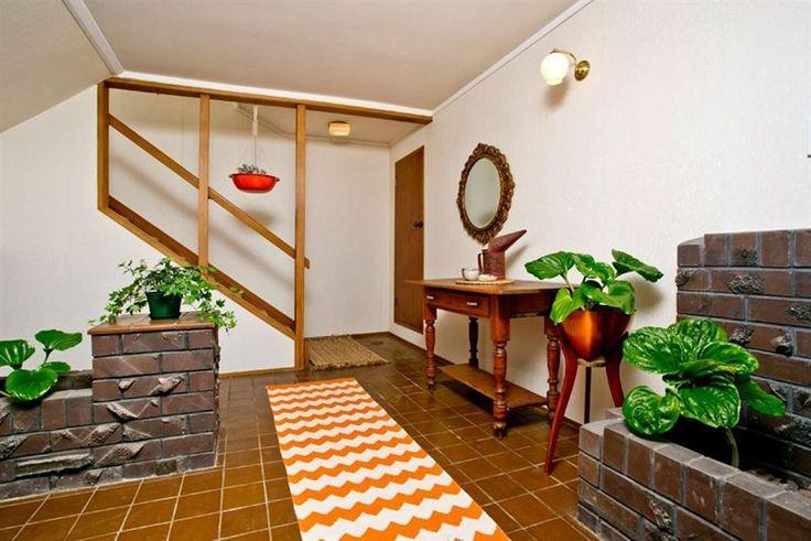 #70's entranceway.  #orange runner @Amy Pinca. #orange hanging planter @Pamela Sances-Kosinski. #vintage items stylists own.  Rame Road, Greenhithe. #PlacesandGraces #HomeStaging