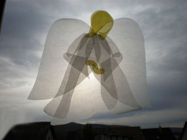 Translucent paper angel, window transparency
