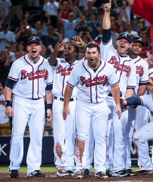PHOTO OF THE DAY: ARE YOU SERIOUS?! The Braves wait at home plate as Chipper rounds the bases following his walk-off homer.    (Photo by Pouya Dianat/Atlanta Braves/Getty Images)