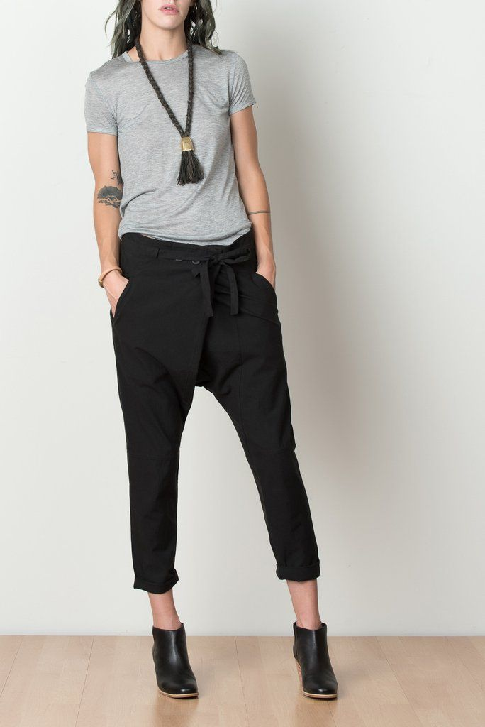 A loose, dropped crotch pant with overlapping waist from Pharaoh. Features unique button and tie closure, back flap pockets, side slash pockets, and tapered, cuffed legs. *Final Sale Item Details - 70