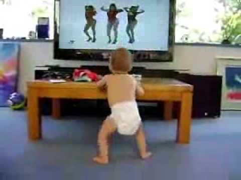 Funny kid dancing to Beyonce singing on TV. The kid just simply rocks the house. This child will go places. Watch at 0:43 when he shakes the leg :)