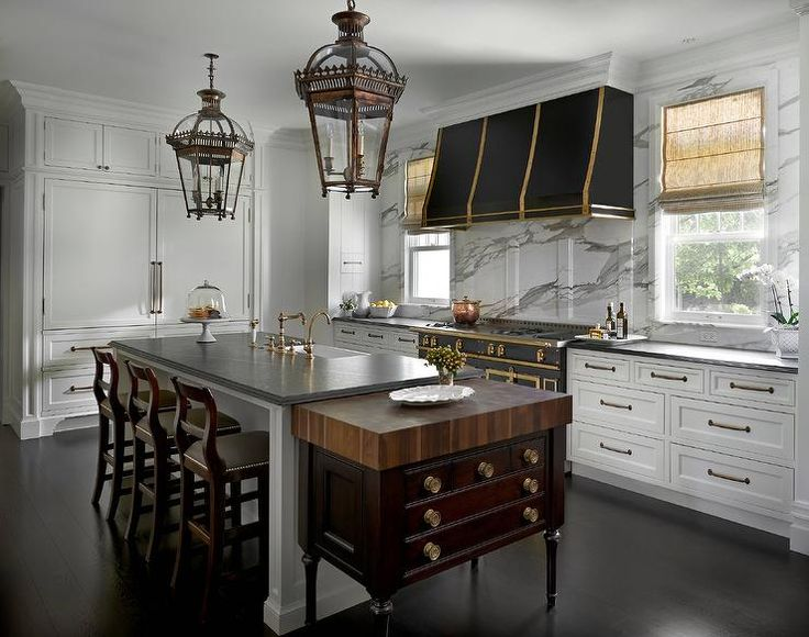 Best A Black Kitchen Hood With Brass Straps Stands Over A 400 x 300