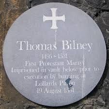Thomas Bilney's plaque, Norwich Guildhall, Gaol Hill, Norwich, England.  Constructed c.1407, the Guildhall served as the seat of city government until 1938. The Undercroft, beneath the east end pre-dates the building, and is thought to be an original feature of the earlier toll-house on this site, and was used to accommodate dangerous criminals.