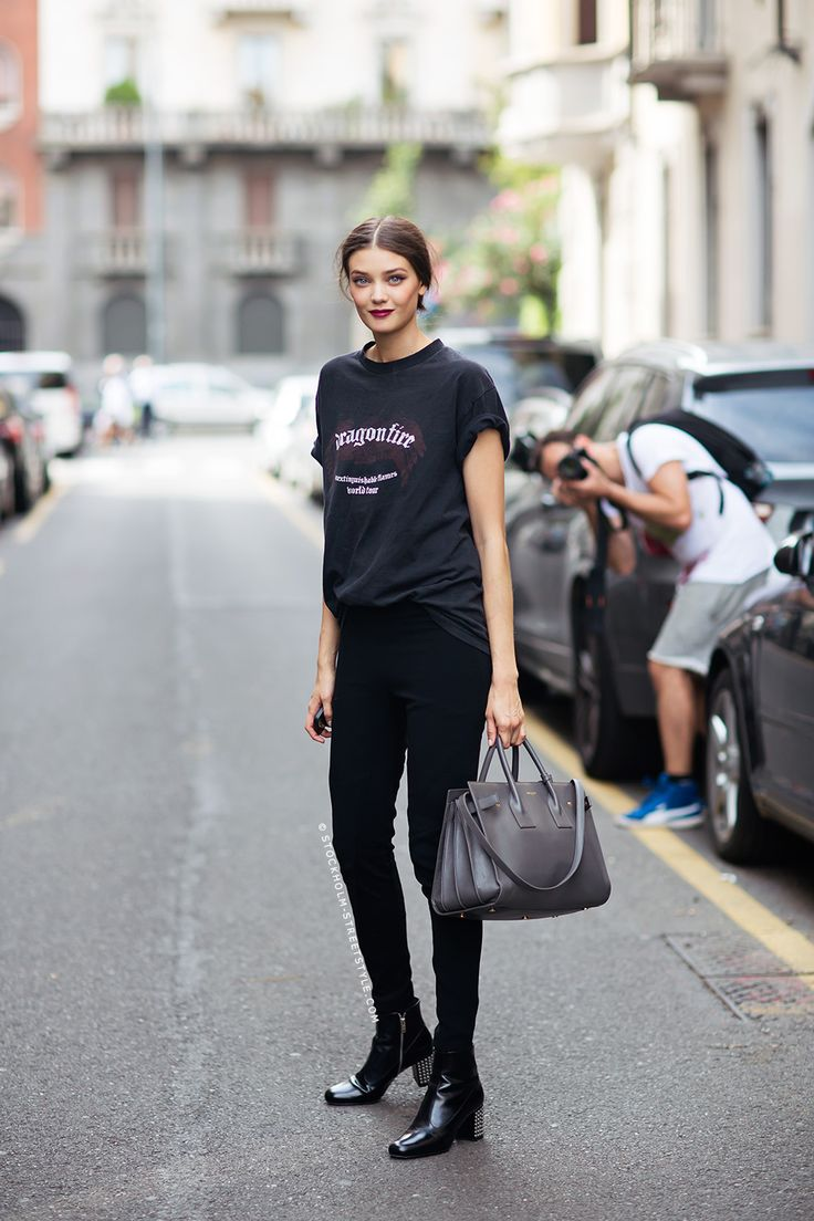 pants from Rag & Bone, boots from Saint Laurent, a Dragon Fire t-shirt and a bag from Saint Laurent