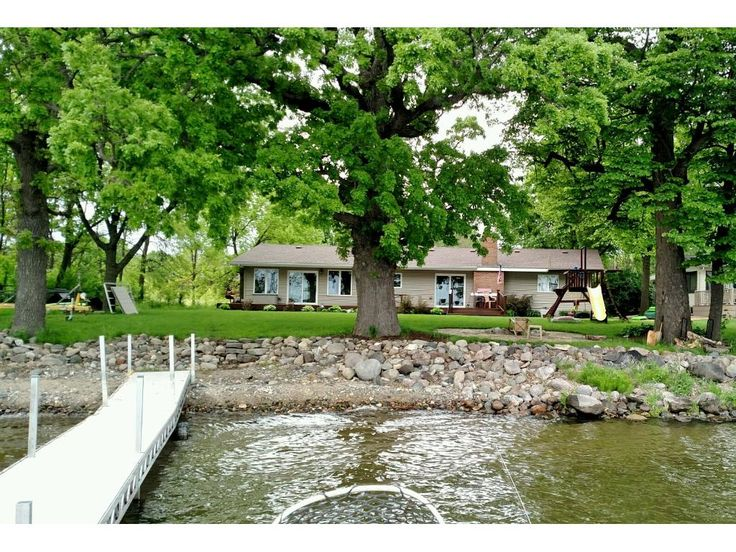 """Great 3 bedroom 2 bath one story on Buffalo Lake. Heated and over sized (27' x 21'6"""") garage. Large maintenance free deck (49'6"""" x 12') can be entered on from informal dining room and living room. Some of the many updates include updated kitchen and both bathrooms, living room carpet, six panel doors, maintenance free deck, circular fire pit, and concrete sidewalk and parking area.  Dock and swingset included."""