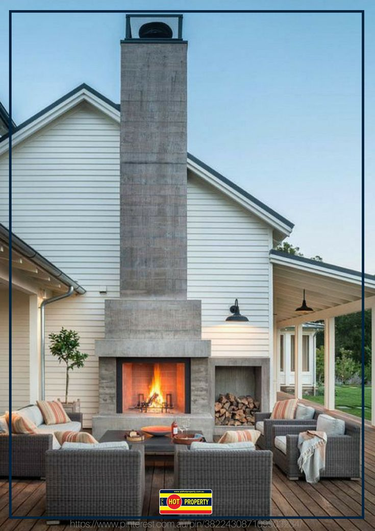 An entertainment area for all occasions equipped with an outdoor fireplace.
