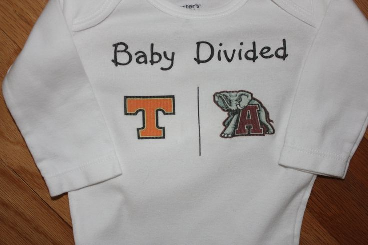 Must get one of these in MSU/UM!  Baby Divided college onesie or toddler shirt. $16.00, via Etsy.