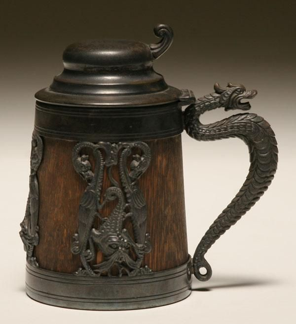 Beer stein; oak body with St. Louis Silver Co. decoration, raised mythical beasts surround body, serpent handle.