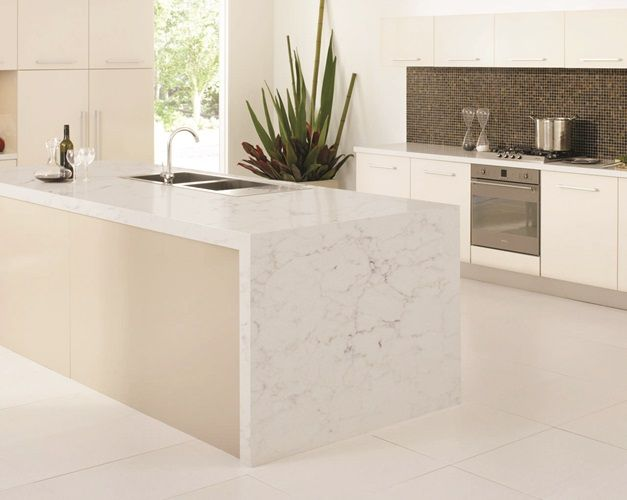 This modern and trendy kitchen island and worktops are a marble effect quartz called Unistone Onyx