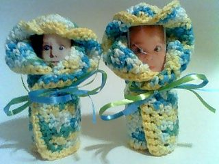 This is my version of Miniature Diaper Babies all wrapped up in a crocheted washcloth, and ready to go on my Daughter-n-law's Crocheted Diaper Cake.