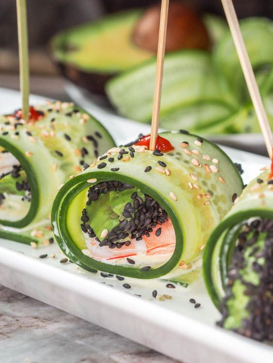 The ultimate low carb, healthy and refreshing summer appetizer or light meal: Asian Shrimp Appetizer in Avocado Wasabi Aioli Cucumber Rolls.